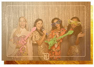 A wedding party enjoying a photobooth